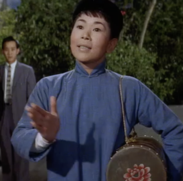 Miyoshi Umeki as Mei Li performing the Flower Drum Song of the title