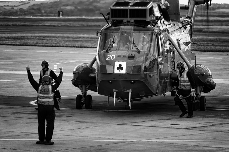 Ground crew remove the chocks from the wheels of the Sea King Mk5.