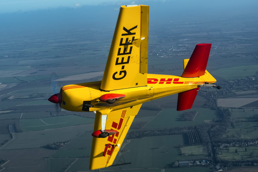 Adrian Willis breaks away from the camera ship in his DHL livered Extra EA-200.