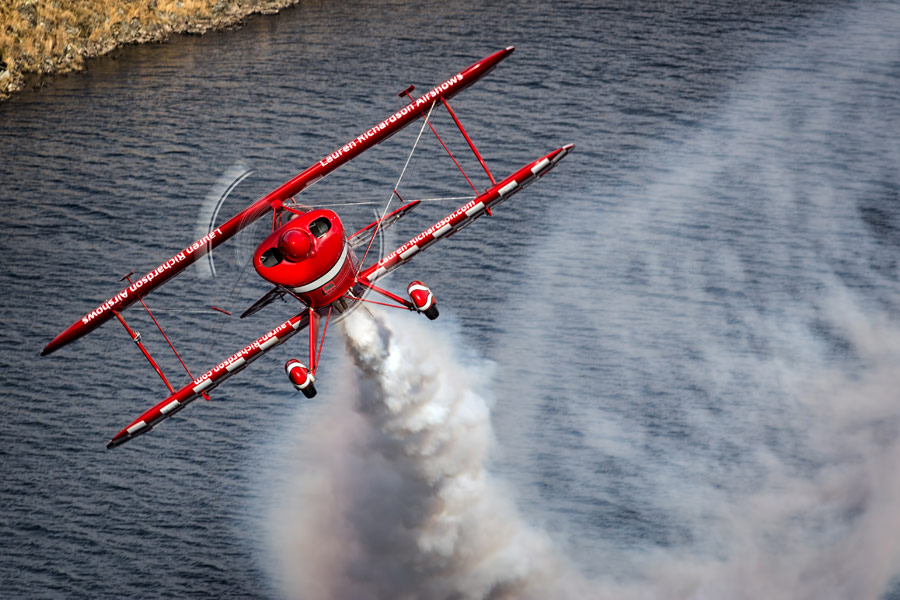 Lauren Richardson in her Pitts S-1S special over the water at Craig Goch reservoir.