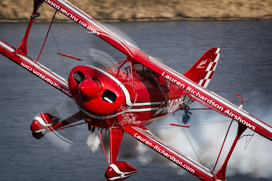Showing off the branding on the leading edges of her Pitts S-1S special.