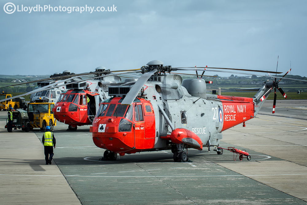 Two 771 NAS Sea King Mk5s on the dispersal at RNAS Culdrose and a 'bagger' ASaC Mk7 Sea King.