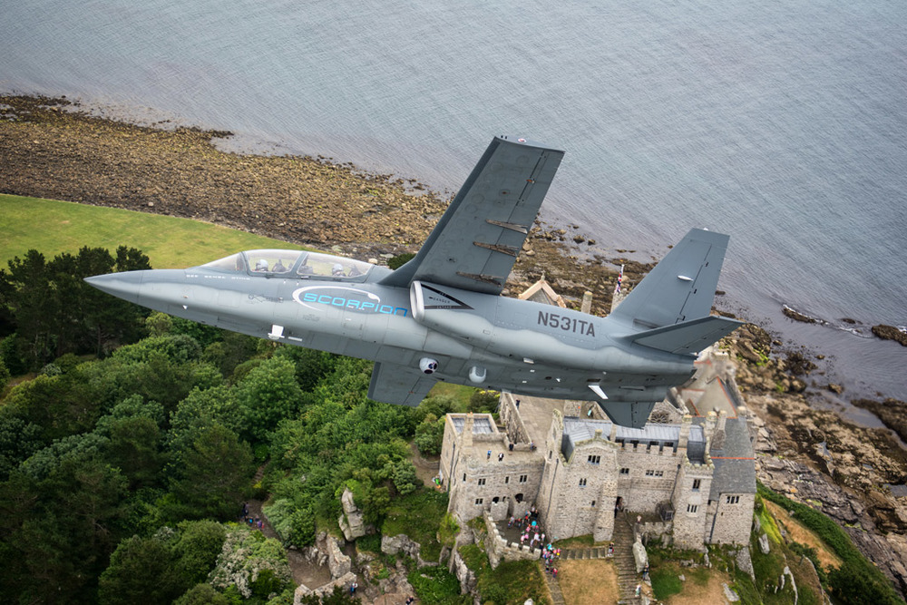 Flying over St Michaels mount in Cornwall as tourists look up at our formation.