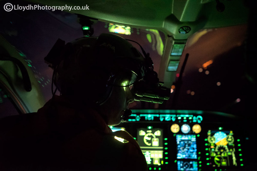 Wiltshire Air Ambulance critical care paramedic surveying a field during an ad-hoc landing for a currency sortie.