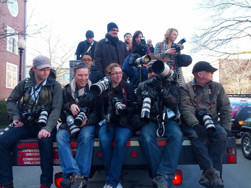 Members of the BPPA and others on the press truck for the Harvard University Hasty Pudding Theatricals Woman of the Year Parade in Cambridge, Massachusetts.