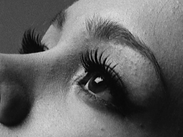100% crop.  You can see the square catchlight of the softbox light modifier in the eye.  Ilford Pan F Plus.