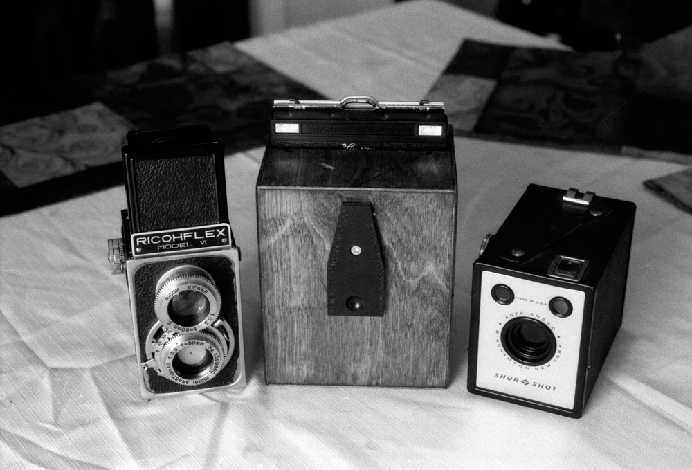 In the middle isthe 4x5 camera used to make my photos, Lensless Camera co. 4x5 pinhole.