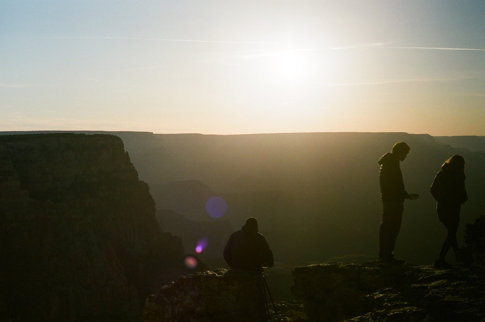 "Michael at the Grand Canyon South Rim: ""I love how the light looks.  You can shoot right into it and there are colored spots.  And you can still kind of see the outlines of people."""