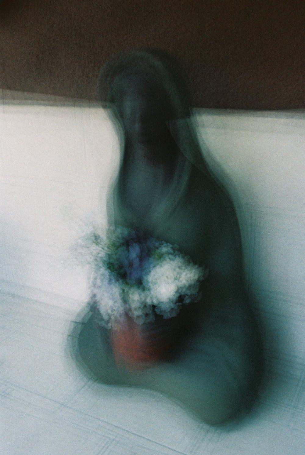 Efrain Bojorquez | Woman with flowers | Canon AE-1 Program | Kodak ProImage 100