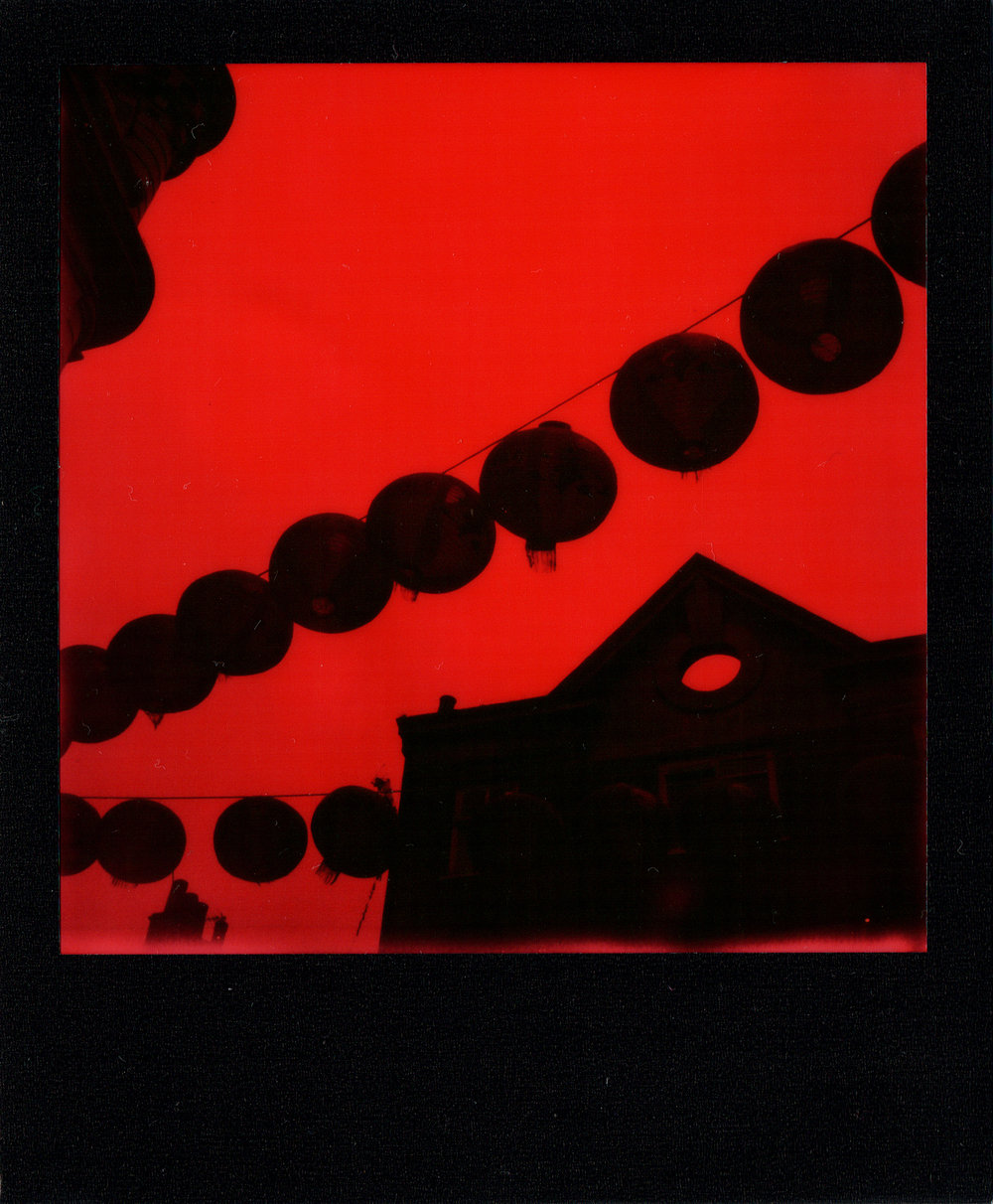 Enigma In China Town | Polaroid SLR680 | Impossible Project Black & Red Duochrome | Claudio Gomboli