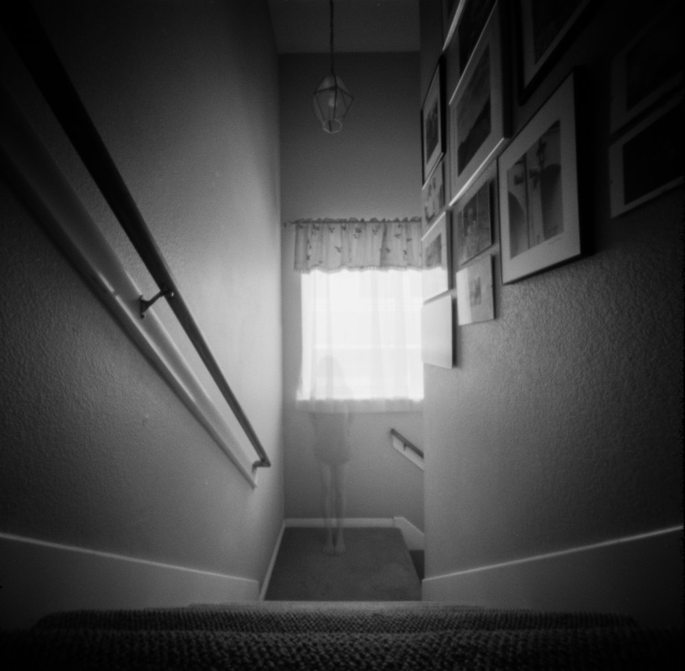 On the Stairs | Ondu Pinhole | Ilford HP5 | Amy Jasek