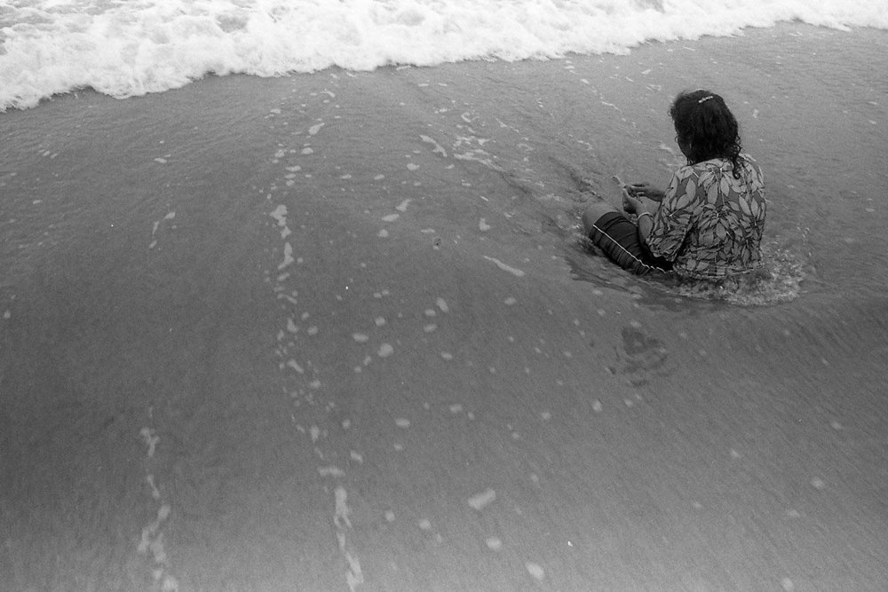 Woman in surf. Manuel Antonio, CR. Shot on Ilford HP5 with Canon AE-1.