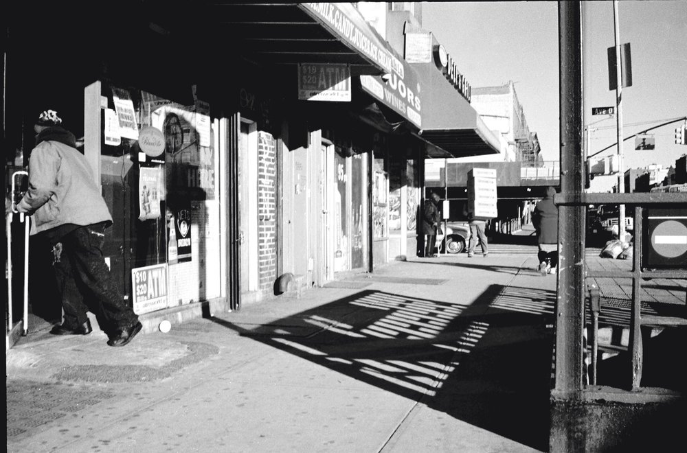A Moment in the Streets. Brooklyn, New York. Photographed on 135 film (35mm). Minolta Hi-Matic