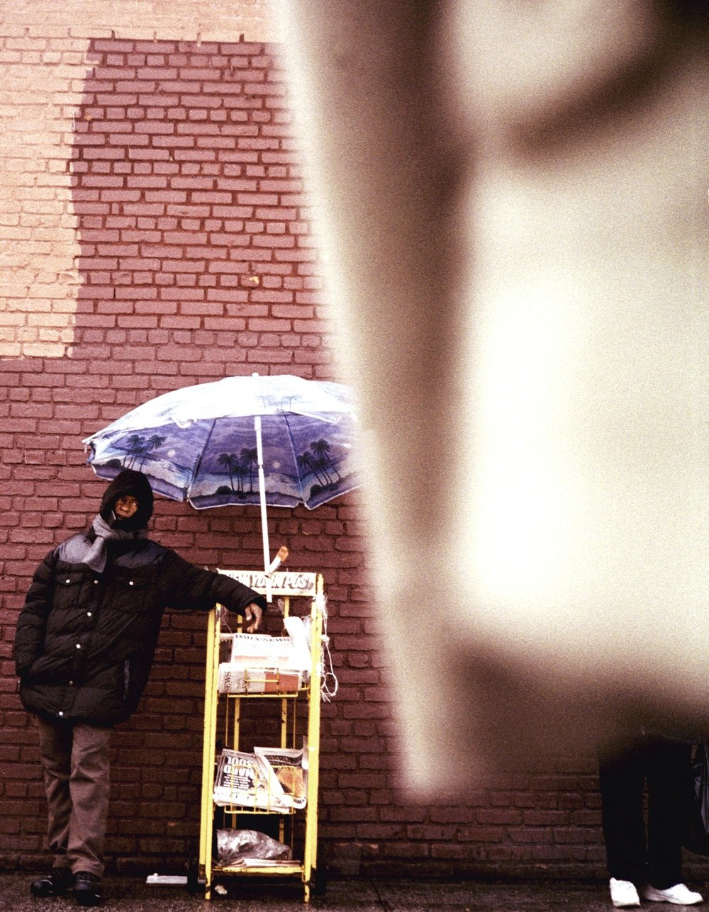 Newspaper vendor. Brooklyn, New York. Photographed on 135 film (35mm). Minolta Hi-Matic
