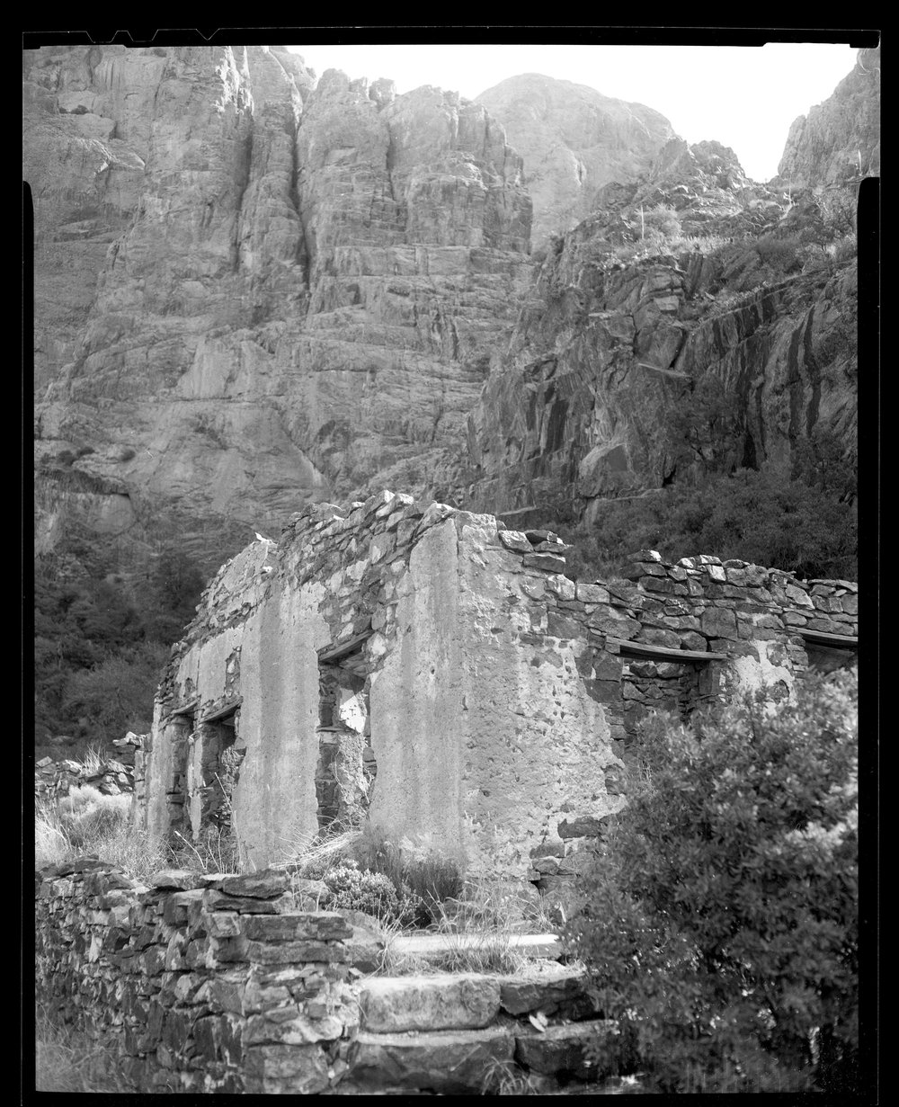 Ruins of the Van Patten Camp, at Dripping Springs in the Organ Mountains, NM. CAMERADACTYL OG 4x5, Expired (1992) Plus-X, Kodak Ektar 127mm