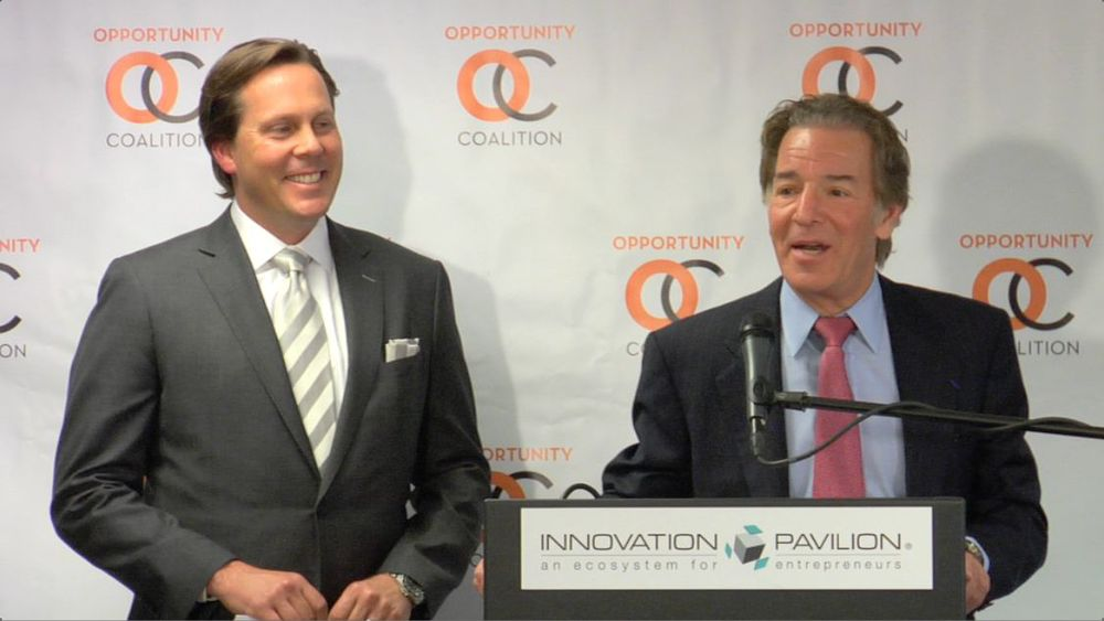 Tom Shane, at right, addresses the Opportunity Coalition on May 15, 2014, as Brian Watson, Founder and CEO, looks on.
