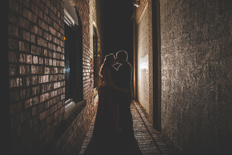 What happens if the bride and groom wanted a silhouette shot but there's no more sun to allow that? Use off-camera lighting to create a silhouette effect!