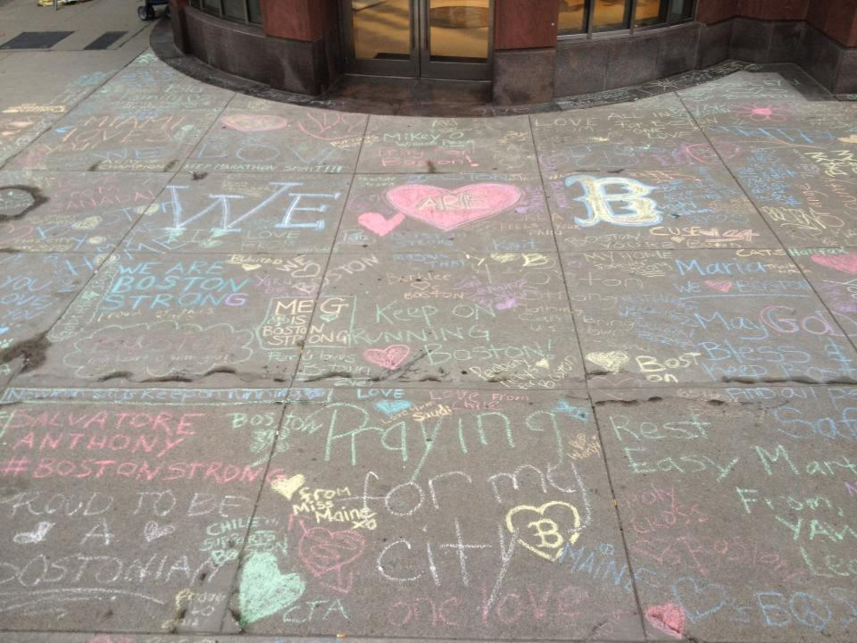 Most sidewalk corners near the bombing became filled with hopeful chalk messages from thousands of sympathetic runners and well-wishers.