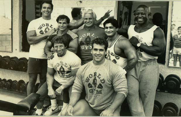 The World Gym ad from a contrived past that shows how falsely represented this world was. From left to right, Arnold Schwarzenegger, Franco Columbu, Eddie Giulliani, Joe Gold, Bob Paris, Danny Padilla, and Jim Morris.