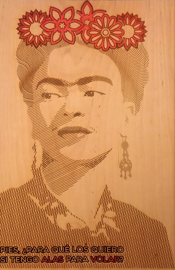"An illustration of Frida Kahlo made in Adobe Illustrator, laser etched into birch plywood and colored with red ink. ""Feet, what good are you when I have wings to fly?"""