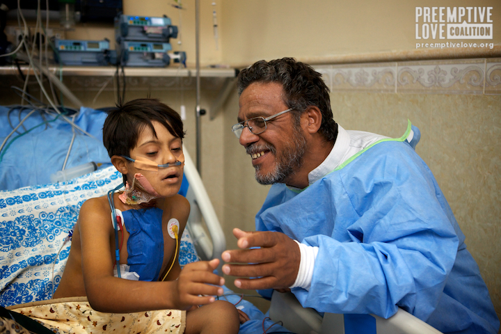 Hussain and his father after a successful surgery. Photo by Matt Willingham.