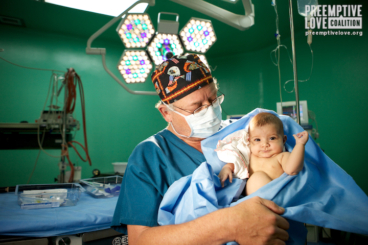 Dr. Novick and an adorable baby! Photo by Matt Willingham.