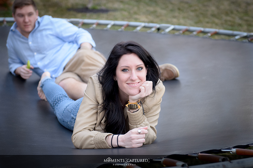 Heather lounging on trampoline