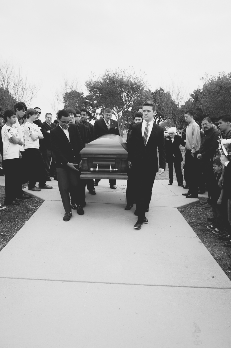 Rolff's friends carrying the casket.