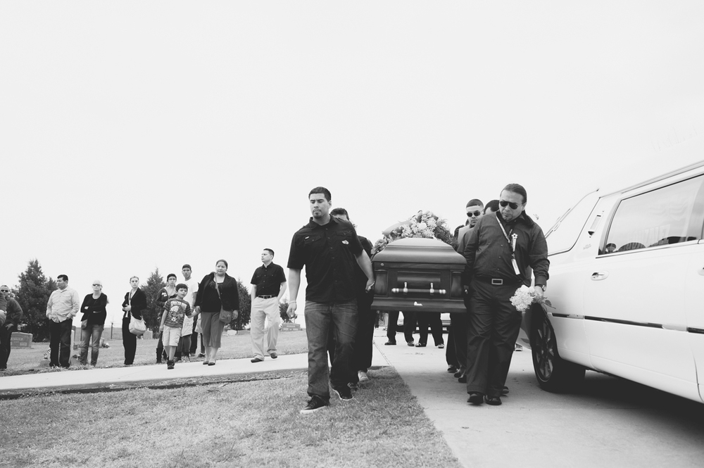 Family carrying the casket to the grave