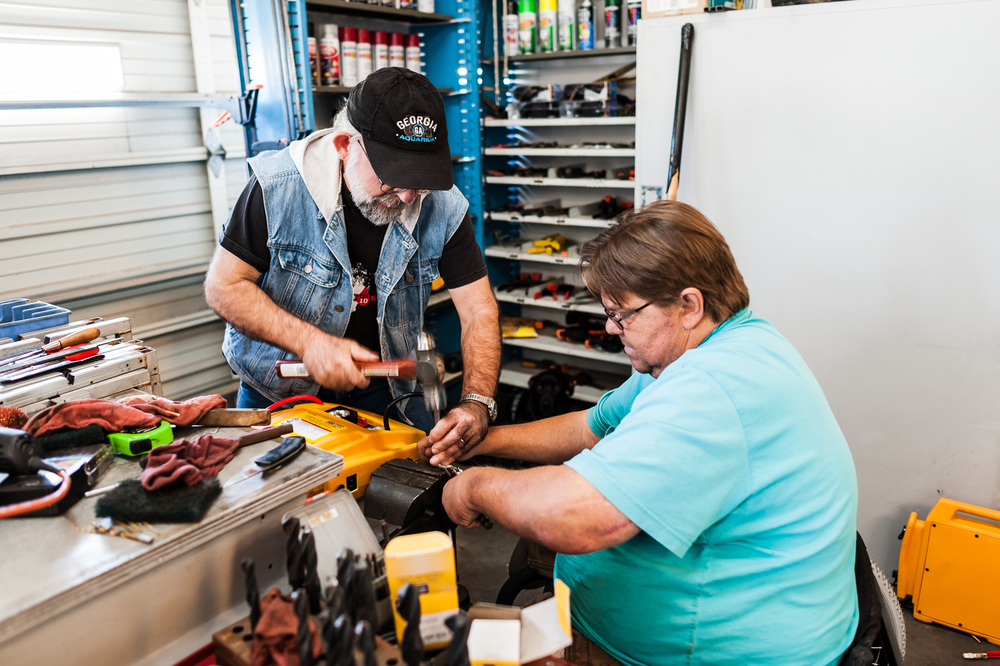 Robert and Tony modifying a batter pack to use on the golf carts.