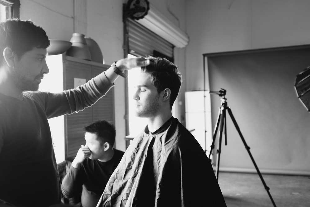 Ricky putting finishing touches on Clay's hair and makeup.