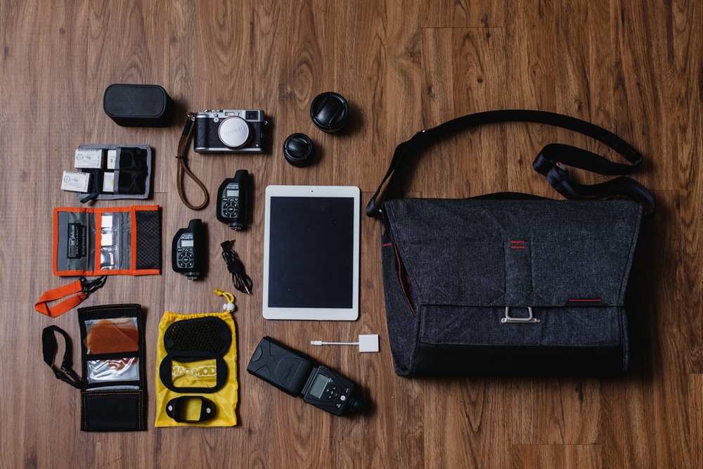 "Ultimate setup ""I wish I can shoot with only this bag"" - My wishful thoughts of one day, going to a job only with this kit. UE Bluetooth Speaker, Think Tank Photo Battery Holder, 4x Fujifilm NP-95 Batteries, Think Tank Photo SD Pixel Pocket Rocket, SD Cards, Fujifilm X100s Camera, Fujifilm WCL-X100 & TCL-X100 Conversion Lenses, Apple iPad Air, Apple Lighting to SD Card Adapter, 2x PocketWizard Plus III Transceiver, Sync cord, MagMod Gel Kit, MagMod Basic Kit (Grid, Gel Slot, & MagGrip), Lumopro LP-180 Flash, and Apple iPad Air, and  Apple Lighting to USB Cable"