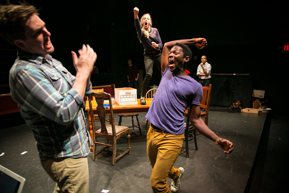 L to R: Another White Man (Patrick Jones), Sarah (Megan Trout) and Another Black Man (Rotimi Agbabiaka) improvise a fight.