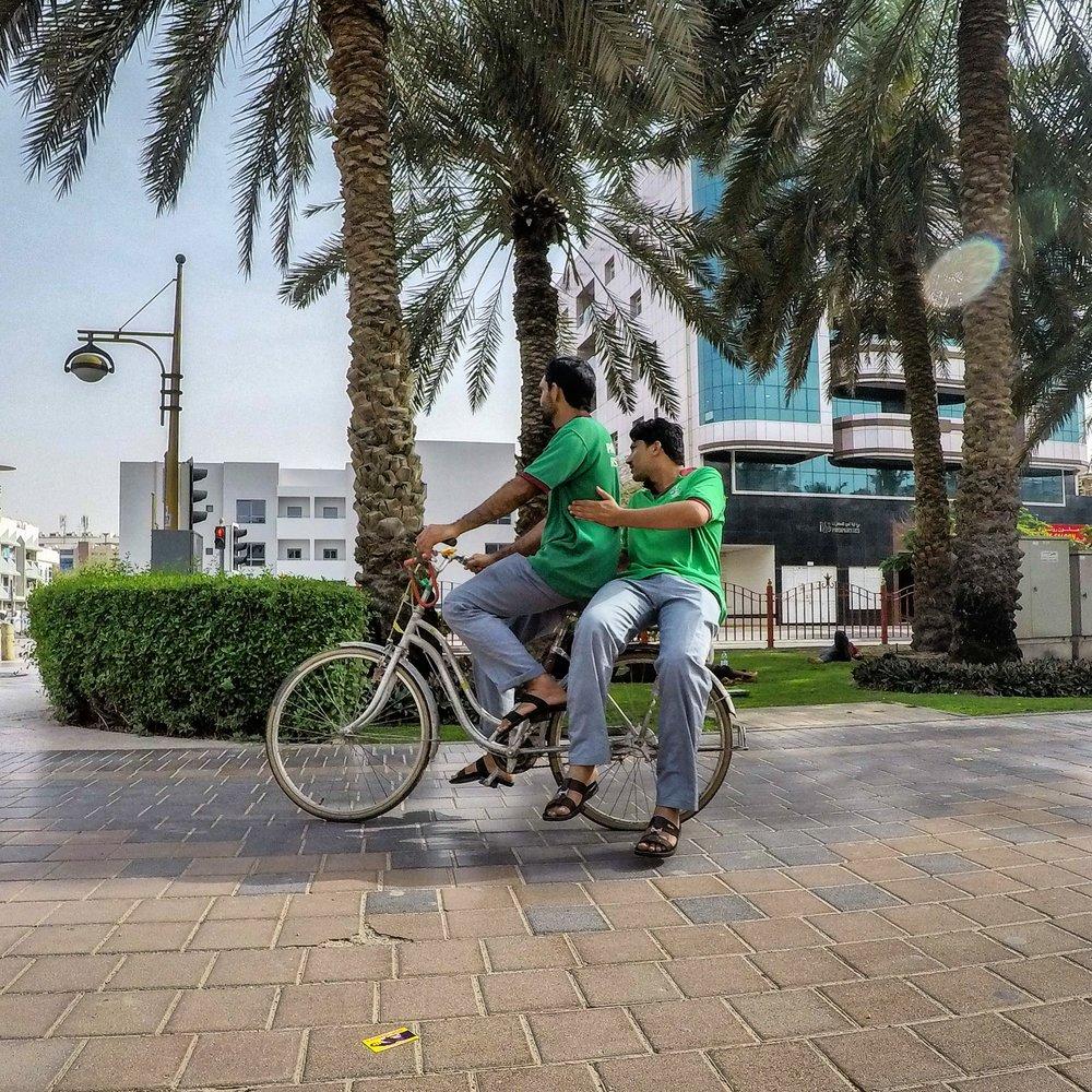 Beats walking, Cyclists riding through park, Deira, Dubai UAE