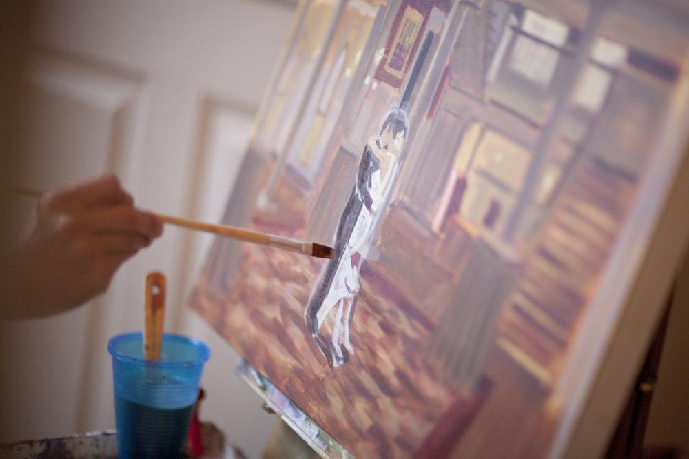Wedding Artist Ben Keys of Wed on Canvas painting live at wedding reception.  //  The Graystone Inn, Wilmington, NC // Photo Courtesy of Blueberry Creative
