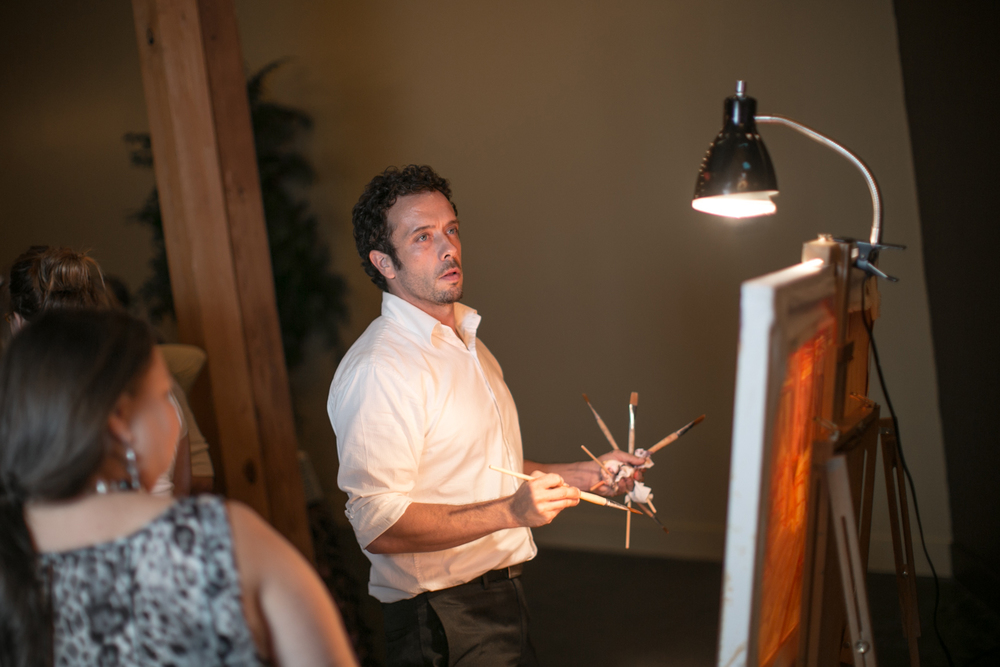 Artist Ben Keys is surrounded by guests as he paints live at a faux wedding reception hosted at The Mill Event Hall in Chattanooga, Tennessee // Photo Courtesy of Imago Photography