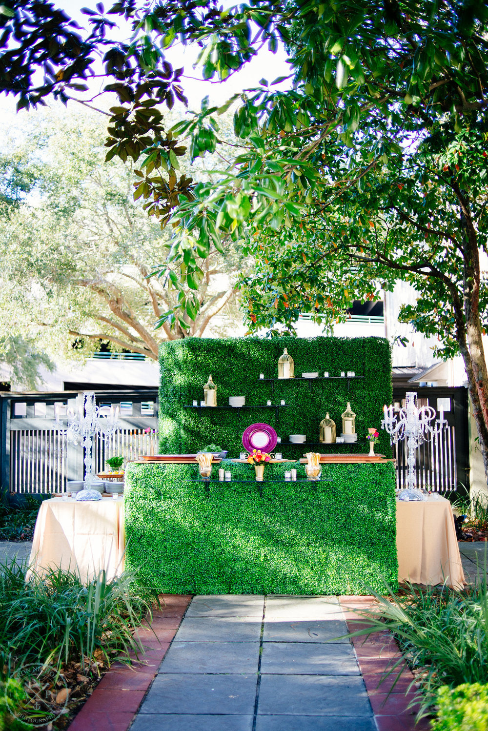 green-grass-bar-garden-reception-turquoise-teal-fuchsia-glass-chandelier