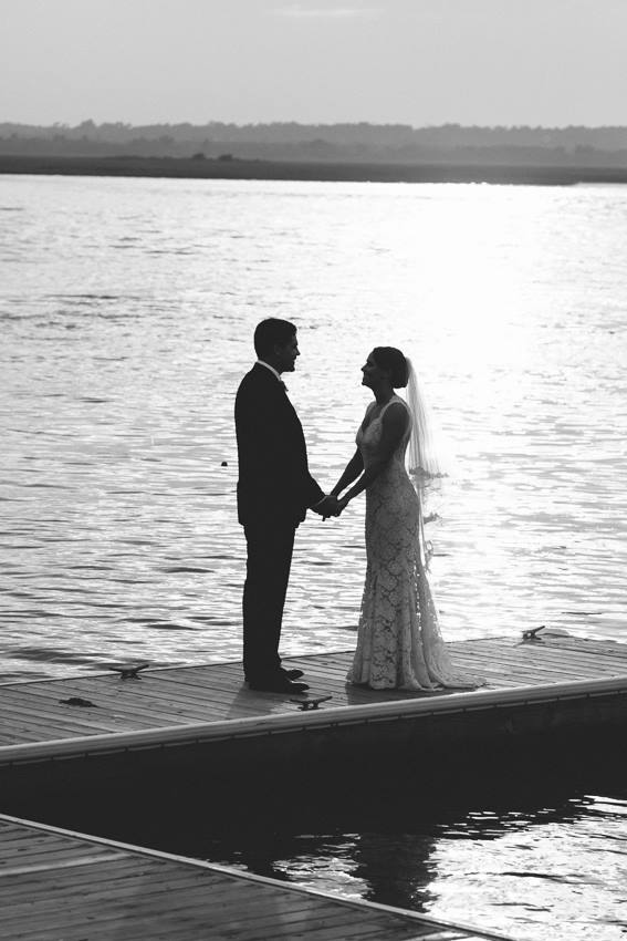 black-and-white-dock-bridal-portrait-beach-front-wedding-wed-on-canvas