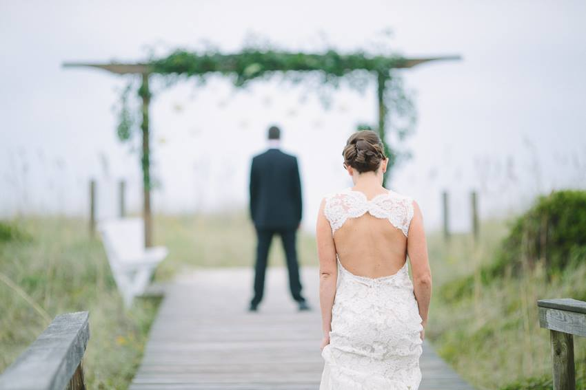 first-look-on-the-beach-wrightsville-wilmington-wedding-artist-lace-keyhole-back