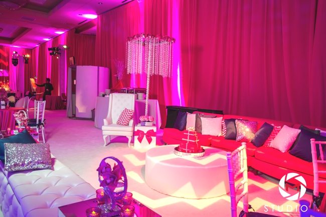 kids-lounge-bat-mitzvah-glitter-pillows-white-carpet-fuchsia-drapes-boxes-and-bows-crystals