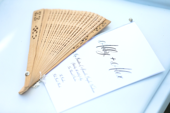 donna-newman-photography-the-breakers-wedding-luxury-program-with-wooden-fan-for-guests-on-hot-wedding-day-beautiful-touch-miami-palm-beach-wedding