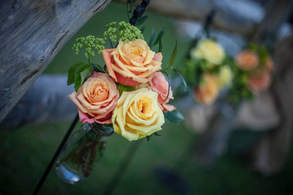 orange-and-yellow-rose-table-centerpieces-wedding-artist-ben-keys-wed-on-canvas-wedding-painter