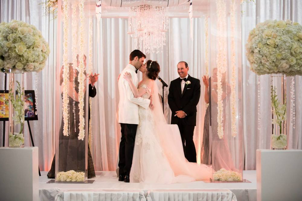 you-may-now-kiss-your-bride-the-polo-club-boca-raton-wedding-chuppah-with-chandeliers-and-hanging-flowers-monique-lhuillier-esme-gown