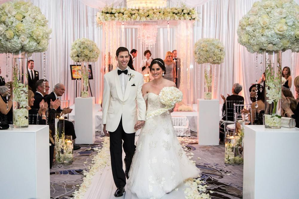 mr-and-mrs-boca-raton-polo-club-luxe-wedding-florals-chuppah-with-chandeliers-and-hanging-flowers-monique-lhuillier-gown-candle-ceremony