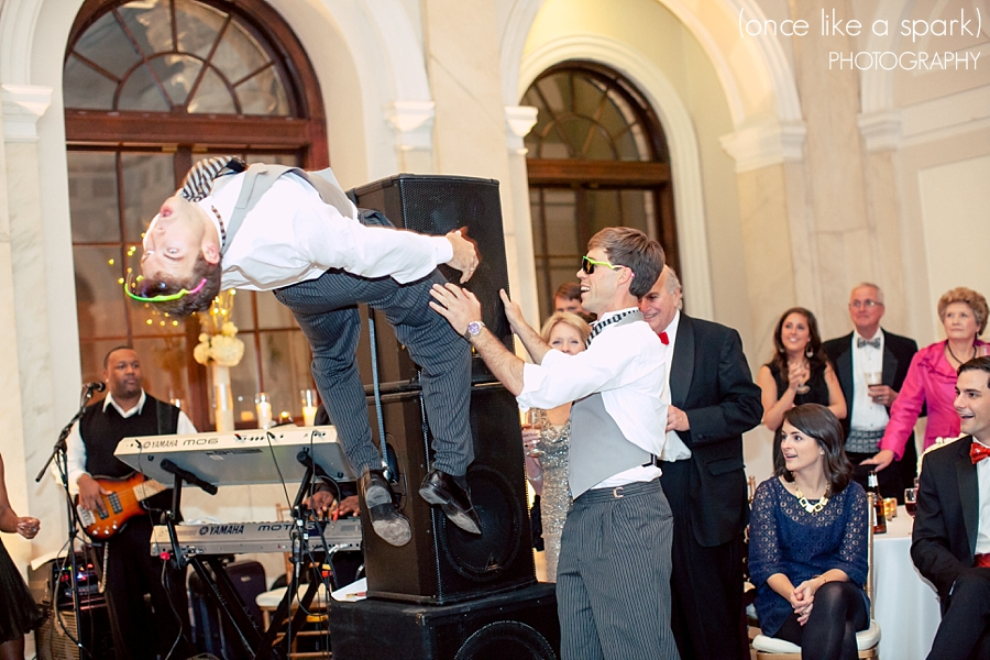 groom-flipping-in-the-air-at-wedding-atlanta-old-courhouse-on-the-square-epic-reception