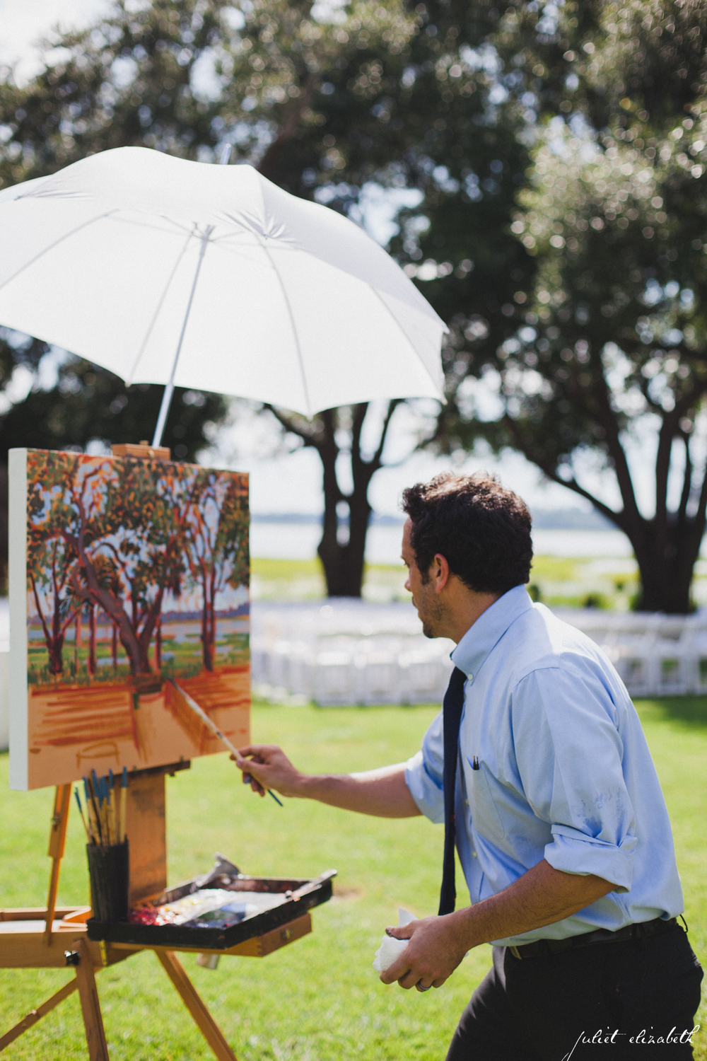 Artist, Ben Keys creating a live painting during Charleston wedding.