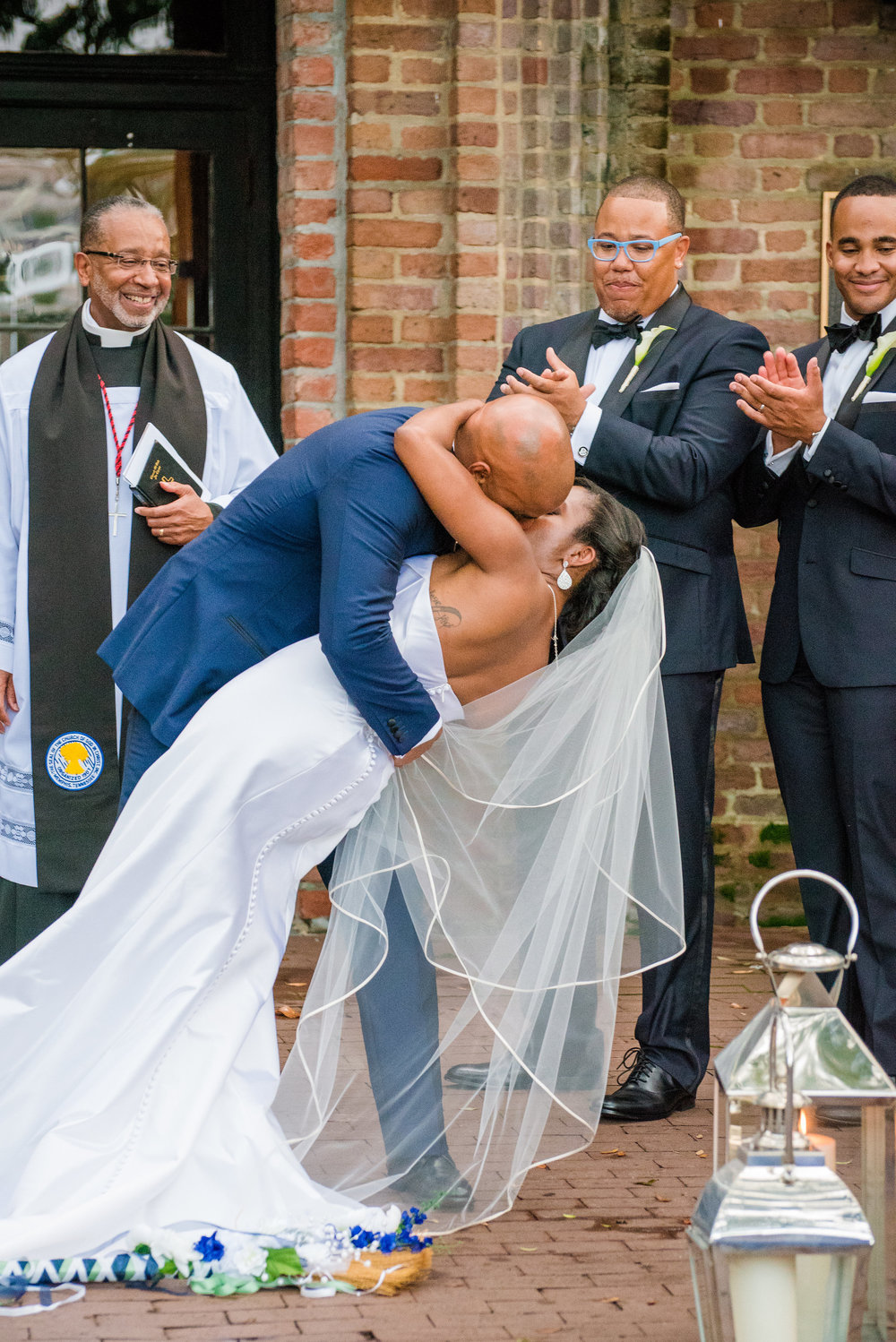 first-kiss-dip-bride-and-groom-wedding-ceremony