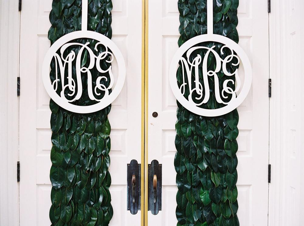 Nothing says southern wedding like magnolia leaves and monograms on the chapel doors!