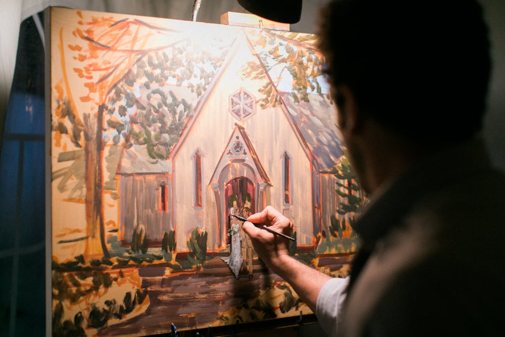Live wedding painter, Ben Keys, capturing bride and groom's ceremony exit from Chapel.