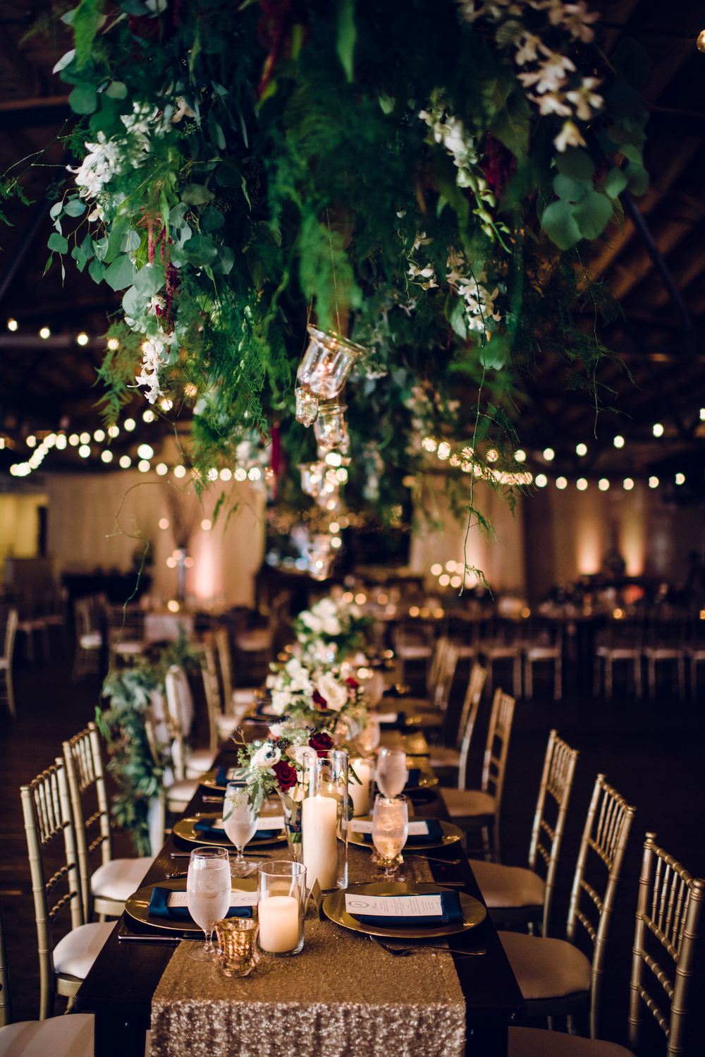 hanging-floral-chandelier-head-table-wedding-reception